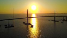 Beautiful 4k aerial drone panorama shot on huge highway road steel bridge across ocean in cold pink evening sunset. Beautiful aerial drone panorama shot on huge stock footage