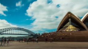 Beautiful 4k time lapse panorama on popular tourist destination Sydney Opera House Australia on bright sunny summer day stock footage