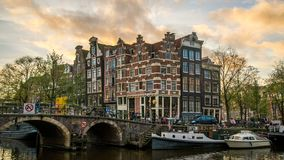 Beautiful 4k timelapse of the corner of the `prinsengracht` and `brouwersgracht`, canals in Amsterdam, just after sunset. In winter. The Amsterdam canals are on stock video