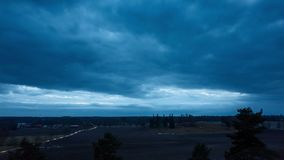 Beautiful 4k timelapse video of nice nature and landscape on spring dusk evening in Sweden Scandinavia Europe. Wonderful fresh blue sky and fields at sunset stock video footage