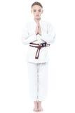 Beautiful karate girl in welcoming gesture Royalty Free Stock Photos