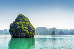 Beautiful karst isle on blue sky background in the Ha Long Bay Stock Photo