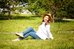 Beautiful kazakh woman. Walking in the summer park Royalty Free Stock Photography