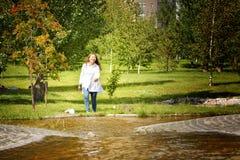 Beautiful kazakh woman. Walking in the summer park Royalty Free Stock Photos