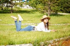 Beautiful kazakh woman. Walking in the summer park Stock Image
