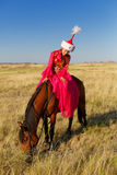 Beautiful kazakh woman and man in national costume Royalty Free Stock Image