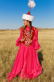 Beautiful kazakh woman and man in national costume Stock Images