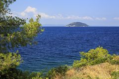 Beautiful Kelyfos (Turtle) Island in Aegean Sea. Stock Photos