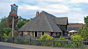 Beautiful kent country thatched roof pub. Photo of a beautiful kent country thatched roof pub and beer garden Royalty Free Stock Photo