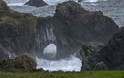 Beautiful keyhole rocks formations. On the Pacific Ocean near Big Sur, California, in foggy day royalty free stock photography