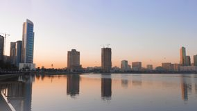 Beautiful Khalid Lagoon at sunrise morning. Cityscape scene with birds, lake and skyscrapers. Beautiful Khalid Lagoon at sunrise morning. Cityscape scene with stock footage