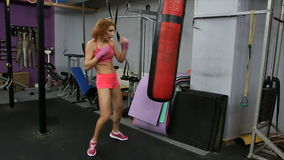 Beautiful Kickboxing woman training punching bag in fitness gym. slow motion.  stock video