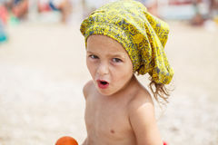 Beautiful kid on the beach Stock Image