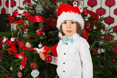 Beautiful kid boy with Christmas tree Royalty Free Stock Photos