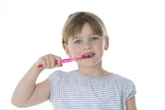 Beautiful kid brushes her teeth Stock Photos