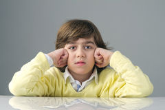 Beautiful kid with deep thoughts thinking  Royalty Free Stock Photo