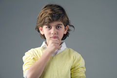 Beautiful kid with deep thoughts thinking  Royalty Free Stock Images