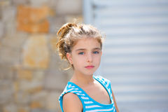 Beautiful kid girl brunette portrait in blue Stock Images