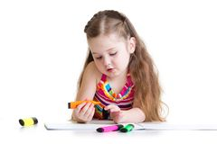Beautiful kid girl drawing pencils in a sketch pad Stock Photography