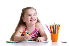 Beautiful kid girl drawing pencils in a sketch pad. Isolated on white background stock images