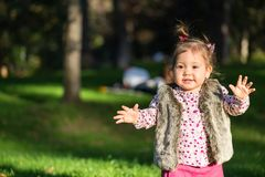 Beautiful kid girl having fun outdoors. royalty free stock photography