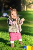 Beautiful kid girl having fun outdoors. royalty free stock photos