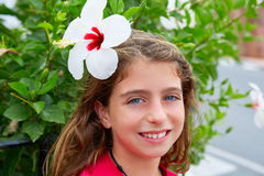 Beautiful kid girl with hibiscus flower in hair Royalty Free Stock Photography