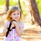 Beautiful kid girl in park forest smiling Royalty Free Stock Photos