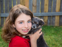 Beautiful kid girl portrait with puppy chihuahua doggy Stock Images