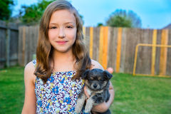 Beautiful kid girl portrait with puppy chihuahua doggy Royalty Free Stock Images