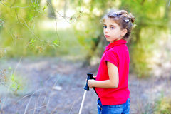 Beautiful kid girl trekking in park forest Royalty Free Stock Photos