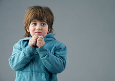 Beautiful kid having a thought isolated Stock Photography