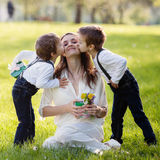 Beautiful kid and mom in spring park, flower and present. Mother Royalty Free Stock Photography