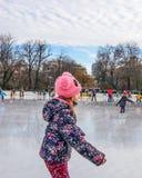 Beautiful kid playing on ice Royalty Free Stock Photos