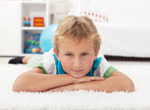 Beautiful kid resting on the floor Royalty Free Stock Photography
