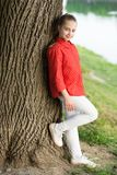 Beautiful kid. Small cute kid with beauty look on natural landscape. Adorable kid with long blond hair in casual style. Little kid wearing fashion summer stock photography