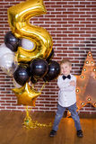 Beautiful kids, little boys celebrating birthday and blowing candles on homemade baked cake, indoor. Birthday party for Stock Photos