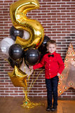Beautiful kids, little boys celebrating birthday and blowing candles on homemade baked cake, indoor. Birthday party for Stock Photography