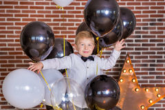 Beautiful kids, little boys celebrating birthday and blowing candles on homemade baked cake, indoor. Birthday party for Royalty Free Stock Photos
