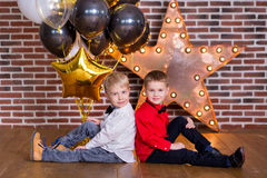 Beautiful kids, little boys celebrating birthday and blowing candles on homemade baked cake, indoor. Birthday party for. Beautiful kids, little boys celebrating Royalty Free Stock Photography