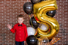Beautiful kids, little boys celebrating birthday and blowing candles on homemade baked cake, indoor. Birthday party for Royalty Free Stock Images