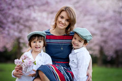Beautiful kids and mom in spring park, flower and present. Mothe Royalty Free Stock Photo
