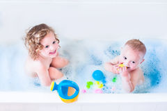 Beautiful kids playing in bath Royalty Free Stock Images