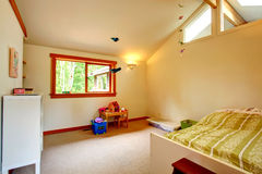 Beautiful kids room with high ceiling Royalty Free Stock Photos