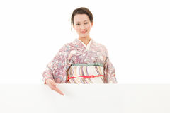 Beautiful kimono woman and white board Royalty Free Stock Photo