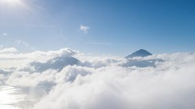 Beautiful Kintamani volcano covered mist. Beautiful aerial view of Kintamani volcano covered mist at morning time in Bali, Indonesia Royalty Free Stock Image