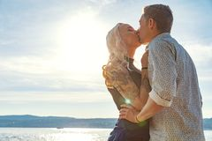 Romantic couple kissing and embrace on beach a sunny day Royalty Free Stock Photo