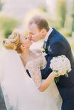 Beautiful kissing wedding couple in spring nature close-up portrait Royalty Free Stock Photography