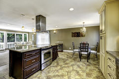 Beautiful kitchen island with granite top and hood Royalty Free Stock Photography