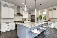 Beautiful kitchen in luxury contemporary home modern interior with island and stainless steel chairs